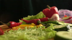 Slow Motion Hot Pepper Fall on cutting board Stock Footage
