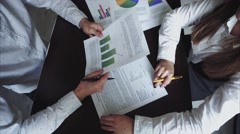 Woman Shows to Man Graph and Documents. Guys Preparing For Projects on Economy Stock Footage