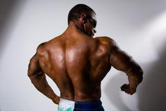 Close-up a spin of muscular man. Stock Photos