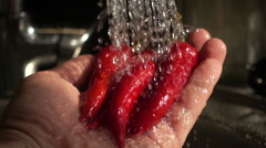 Slow Motion hot pepper washed under the tap Stock Footage
