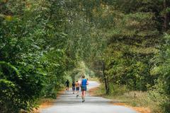 Group runner marathon running in autumn forest Stock Photos