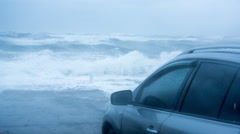 Car Parked Near To Extreme Stormy Sea Slow Motion Stock Footage