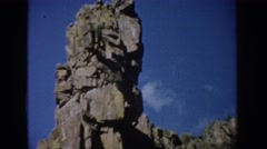 1959: a large rock structure on top of a mountain with rocks COLORADO Stock Footage
