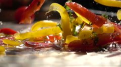 Slow motion vegetable mix falls into the water Stock Footage