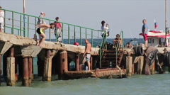 Crimea, Koktebel 15 August 2016 jumping from a pier into the water Stock Footage