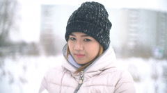 Thai Woman playing with snow slowmotion Stock Footage