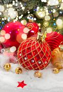 Red christmas ball under evergreen tree Stock Photos