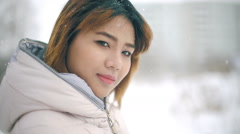Young Asian Woman winter portrait slowmotion Stock Footage