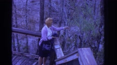 1972: woman picking winter berries from decking. PHILADEPHIA PENNSYLVANIA Stock Footage