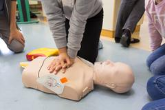 First aid resuscitation course using AED. Stock Photos