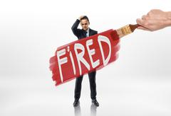 Hand drawing red line with sign 'fired' over the businessman Stock Photos