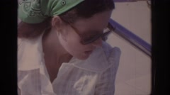1972: a middle aged lady wearing a white shirt and talking causally. PHILADEPHIA Stock Footage