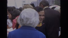 1972: various people gathered outside after a graduation ceremony PHILADEPHIA Stock Footage