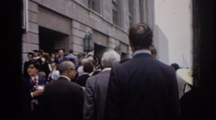 1972: well-dressed crowd stands around outside philadelphia civic center Stock Footage