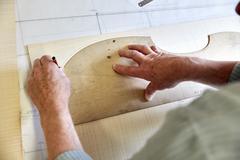 A violin maker's workshop Skilled craftsman drawing Stock Photos