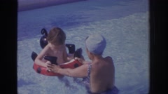 1972: a woman is teaching her baby to swim PHILADEPHIA PENNSYLVANIA Stock Footage
