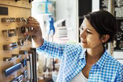 Woman looking at merchandise in an interior design store Stock Photos