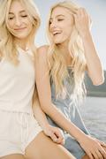 Portrait of two blond sisters on a sail boat Stock Photos