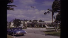 1973: cars parked alongside road building wind blowing fast NAPLES FLORIDA Stock Footage