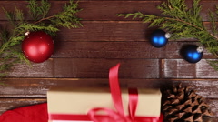 Top view hands gives a gift with the inscription Merry Christmas at wooden desk Stock Footage