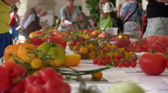Depth of Field, people at tomato exhibition Stock Footage