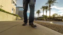 Male legs walking down the street, surroundings in reverse Stock Footage