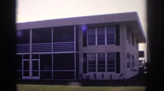 1973: palm trees being blown by wind view of a building NAPLES FLORIDA Stock Footage
