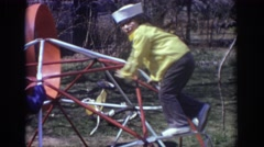 1973: little girl and boy playing on the jungle gym. PHILADEPHIA PENNSYLVANIA Stock Footage