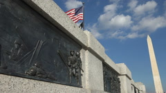 Close on one bronze bas relief panel, WW II Memorial Stock Footage