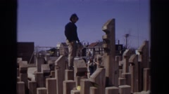 1973: adult and child climbing on feature in park PHILADEPHIA PENNSYLVANIA Stock Footage