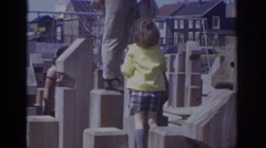 1973: father and son playing in the apartment kids play area. PHILADEPHIA Stock Footage
