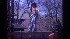 1973: girl trying to keep balance while walking the play plank. PHILADEPHIA Stock Footage
