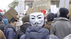 DEMONSTRATION AGAINST CETA, TTIP. MAN WITH THE ANONYMUS MASK. Stock Footage