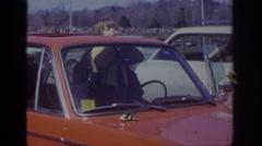 1973: child waving from a car sunroof. PHILADEPHIA PENNSYLVANIA Stock Footage