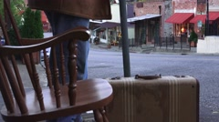 Old gold mining town, man waits at bus stop Stock Footage