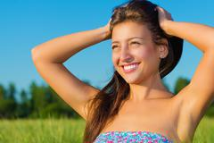 Portrait of a beautiful young woman in the summer on the nature Stock Photos