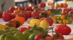 Table full of colorful and rare old tomato varieties Stock Footage
