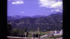 1973: beautiful landscape scenery with views of greenery and mountains around  Stock Footage