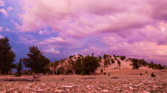 Timelapse of Heavenly Sunset Afterglow at Mountain Summit -Pan Right- Stock Footage