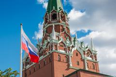 Spasskaya Tower of Kremlin and russian flag in Moscow Stock Photos