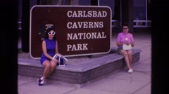 1973: two women posing in front of the carlsbad caverns sign, NEW MEXICO Stock Footage