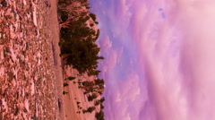 Timelapse of Heavenly Sunset Afterglow at Mountain Summit -Vertical/Pan- Stock Footage