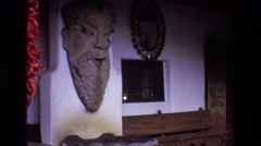 1973: that statue on the wall is so scary and creepy at the same time NEW MEXICO Stock Footage