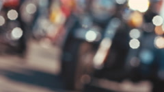 Beautiful bokeh blurred motorcycles ringing down the street Stock Footage