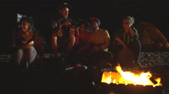 Group of backpackers relaxing near campfire after a hard day Stock Footage