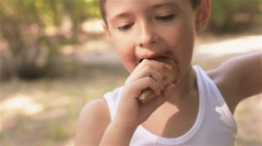 The boy smeared the ice cream and eats it Stock Footage