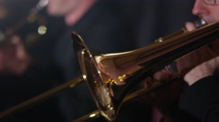 4K Close up on trombone being played during orchestra performance Stock Footage