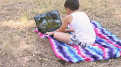 Boy playing shooting games on a laptop Stock Footage