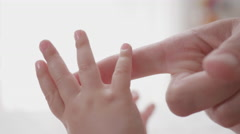 Close-up of Cute Little Hands Reaching for Mother's Hands Stock Footage