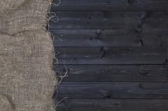 Burlap hessian or sacking on dark wooden background Stock Photos